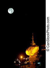 Night scene Kyaikhtiyo Pagoda in full Moon night