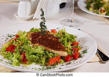 Appetizing Meaty Main Dish on Lettuce and Tomatoes - Close...