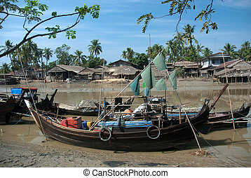 Traditional Myanmar village on estuary in Kyaikto...
