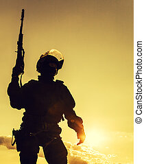 police officer with weapons - Silhouette of police officer...