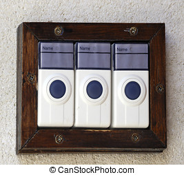 Three door bells - Three modern electric door bells without...