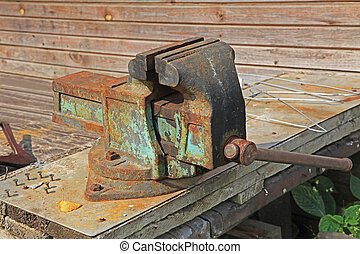 bench vise - old and rusty bench vise at a workshop