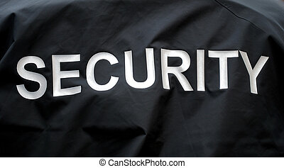 security - macro of a jacket of a security guard