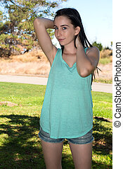 Teal tee - Pretty young brunette in a teal tee shirt and...