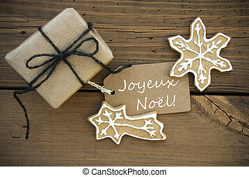 Joyeux Nol on a Banner with Christmas Decoration - The...