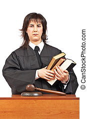 Angry female judge holding the books Shallow depth of field