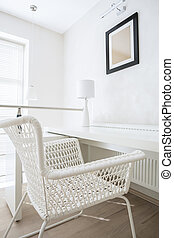 Interior with white wicker chair