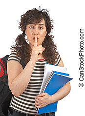 Silence please - Young student woman making a gesture to be...
