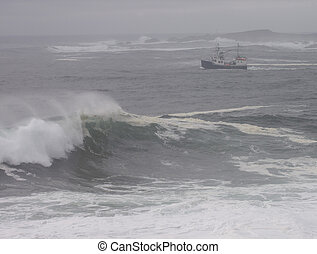 fishing boat and angry sea - An Atlantic wave breaks as a...