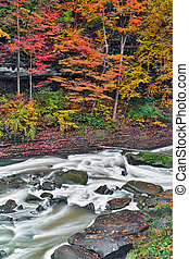 Autumn Rapids - Whitewater flows around boulders in Ohio's...