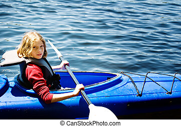 girl kayaking - ten year old girl in a kayak