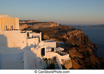 View over a house in Thira at sunset in Santorini, Greece