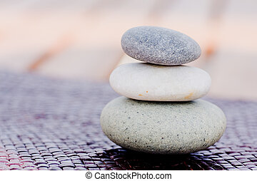 Zen stones stacked - Three zen stones stacked on top of each...