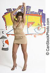Dancing - Hip Hop fashion model dancing in front of graffiti