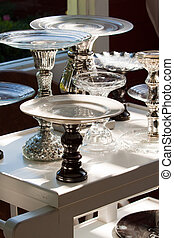 Footed Plates - Plates stand upon footed holders for serving...