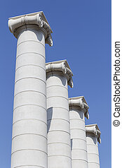 Columns - Four columns against a bright blue sky