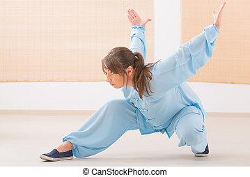 Woman doing qi gong tai chi exercise - Beautiful woman doing...