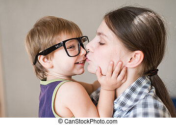 Young beautiful woman kissing her son