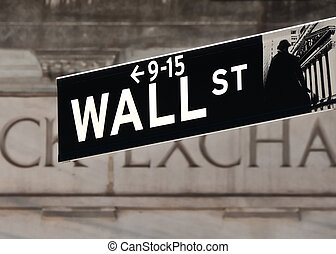 Wall street sign in front of Stock Exchange building in New...