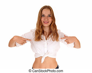Blond woman pointing. - A beautiful young woman in a white...