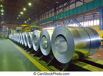 packed coils of steel sheet inside of plant
