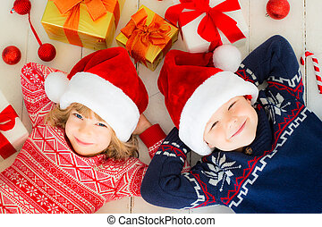 Children with Christmas decorations - Portrait of happy...