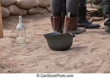 Soldier helmet - Old soldier helmet upside down on sand...