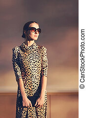 Street fashion portrait stylish pretty woman in a dress with...