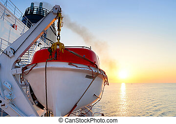 Lifeboat - View of a lifeboat on a cruise ship at sunrise