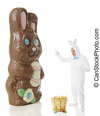 Shocked by a Giant Chocolate Bunny - A senior man in a white...