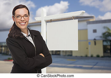Woman In Front Commercial Building and Blank Real Estate...