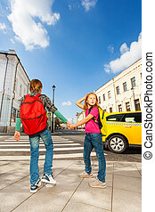 Boy with girl hold hands and stand near road - Boy and girl...