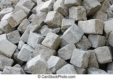 Stone Blocks - Dump of stone pavement blocks ready to use.