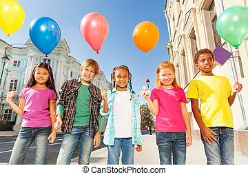 Multinational children with balloons standing -...