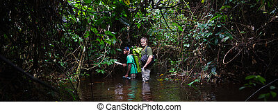 The photographer in the jungle - JUNGLE, CONGO, AFRICA -...