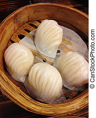 closed up dimsum fill with shrimp in bamboo basket
