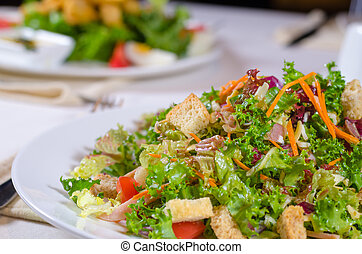 Plate of healthy leafy green salad with croutons - Plate of...