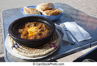 Tajine - a delicious Moroccan dish as served in a restaurant in Marrakesh, Morocco