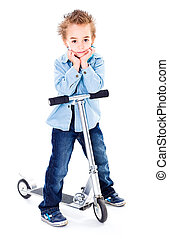 Little boy with his scooter