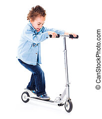 Little boy playing with his scooter