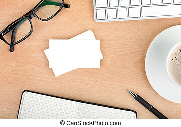 Blank business cards with supplies and coffee cup on wooden...