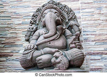 Hindu God Ganesh statue with stone background