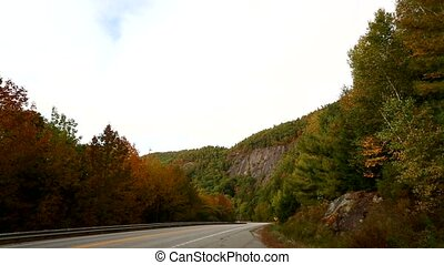 Rural road near Camden Maine - Video of a car heading toward...