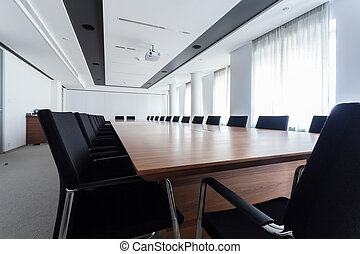 Table in a meeting room - Enormous table in a meeting room,...