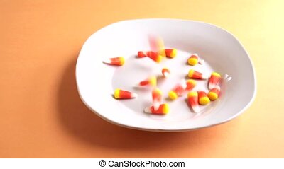 Candy corn filling dish - Video of Halloween candy corn...