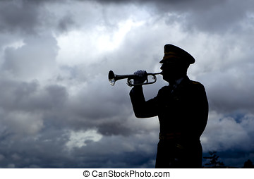 Silhouette of bugle player - Silhouette of a man playing...