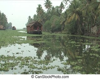 Alleppey, India - Houseboats are converted rice barges with...