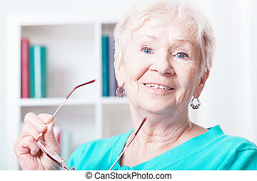 Portrait of smiling senior woman at her house