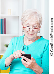 Modern senior woman - Image of modern senior woman using...