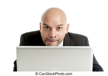 businessman typing on computer keyboard with funny face...